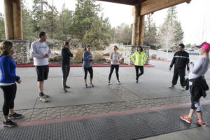 Group of people in workout clothing prepping to workout
