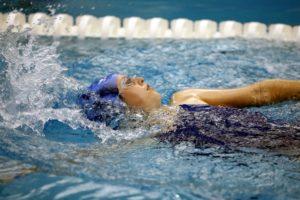 Person doing the backstroke