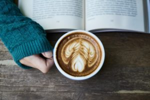 person reading with a latte