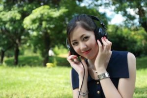 Person wearing headphones in a park