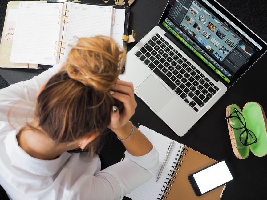 Stressed person working on their computer