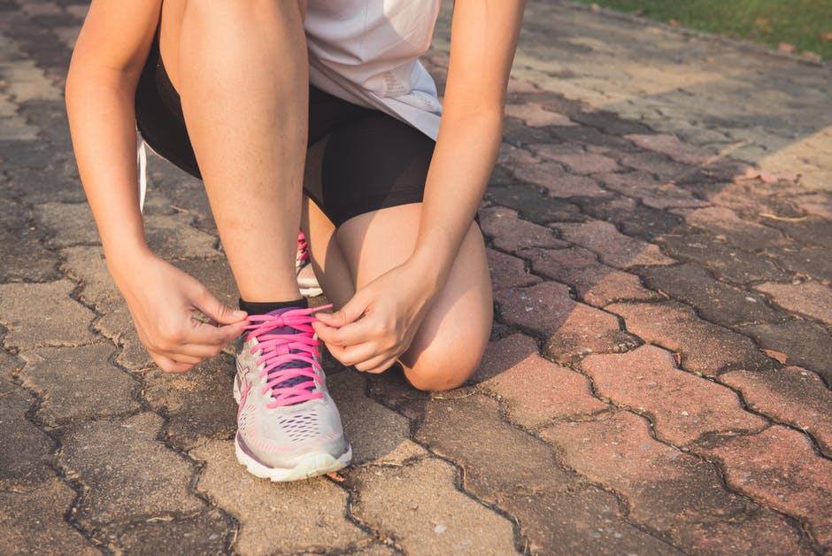 runner tying their shoe