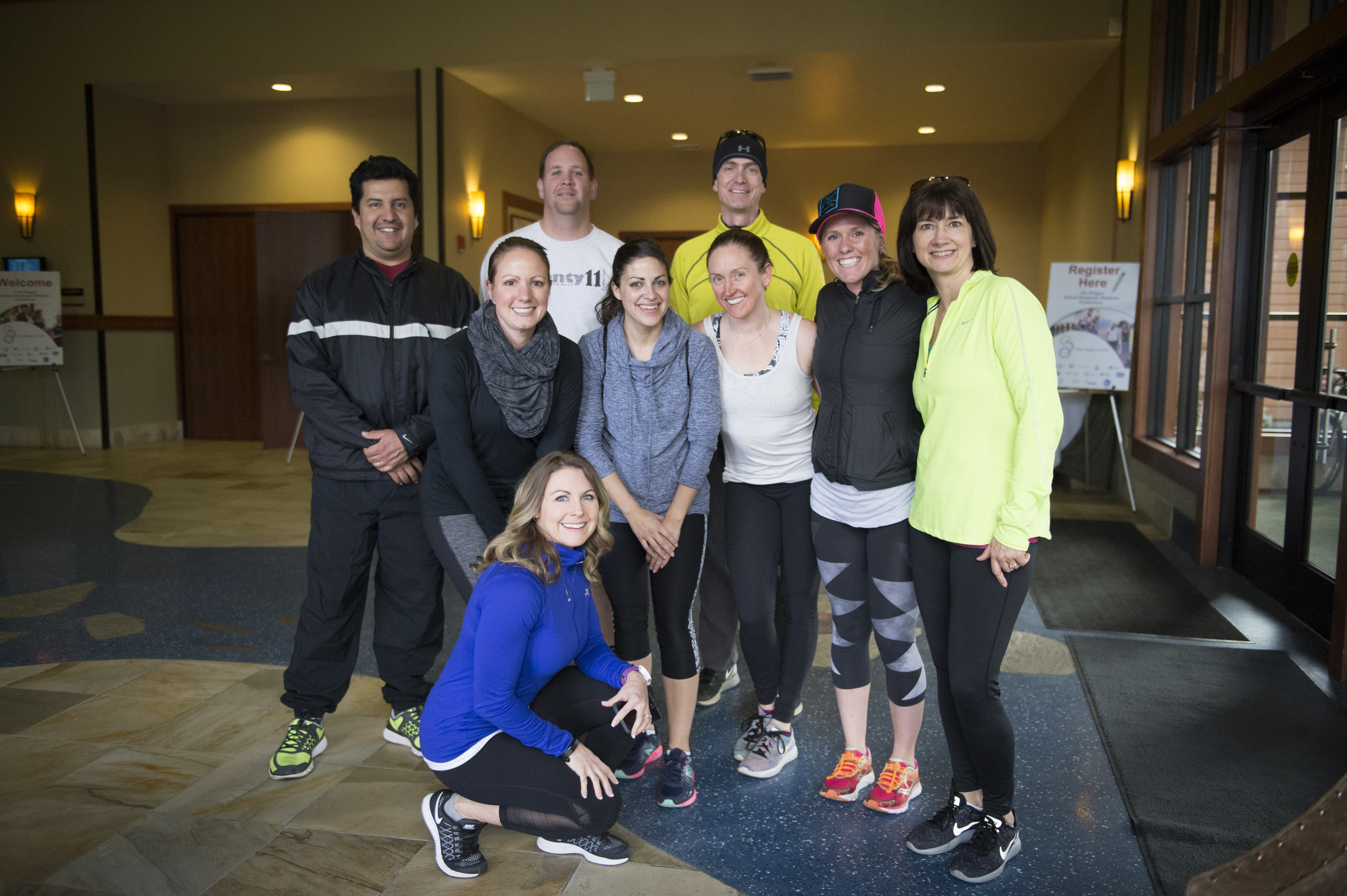 smiling group of people in workout gear posing