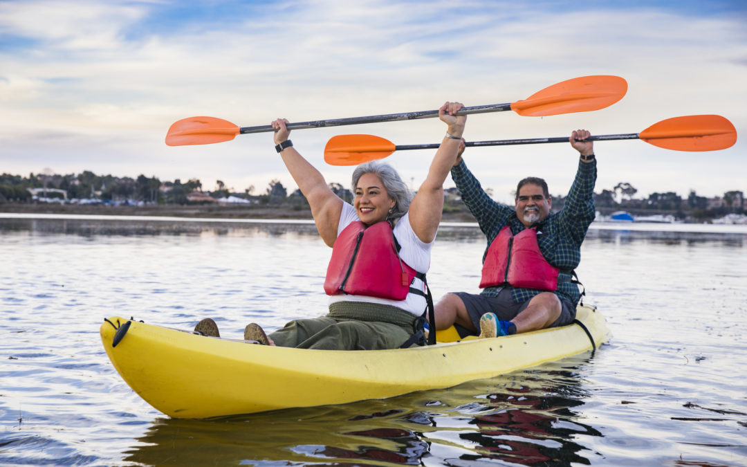 two people in a yellow kayak smiling
