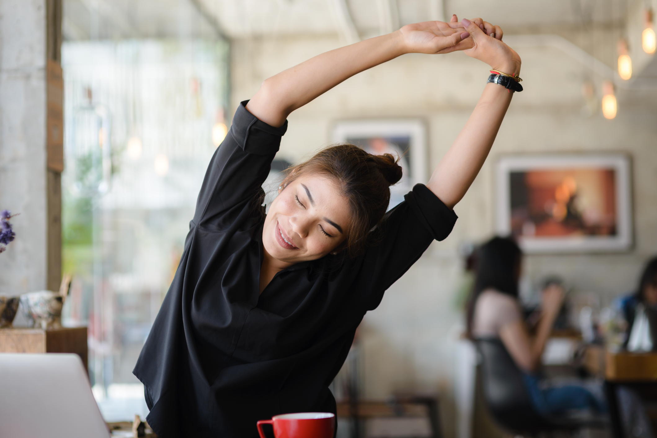 person stretching in a coffee shop