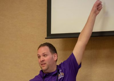 Person in a purple shirt pointing to their presentation