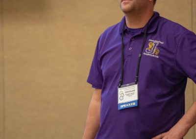 Person in a purple shirt presenting