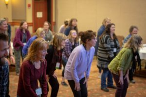 Group of people learning a dance