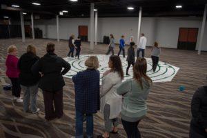 People walking around a mindfulness maze