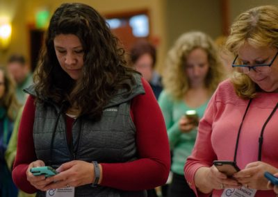 Group of people looking at their phones