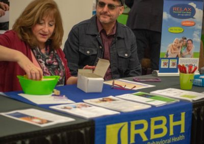 Two people at the RBH table
