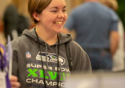 Person in Seahawks sweatshirt smiling