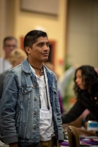 person standing wearing a jean jacket