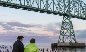 People staring at the Astoria bridge
