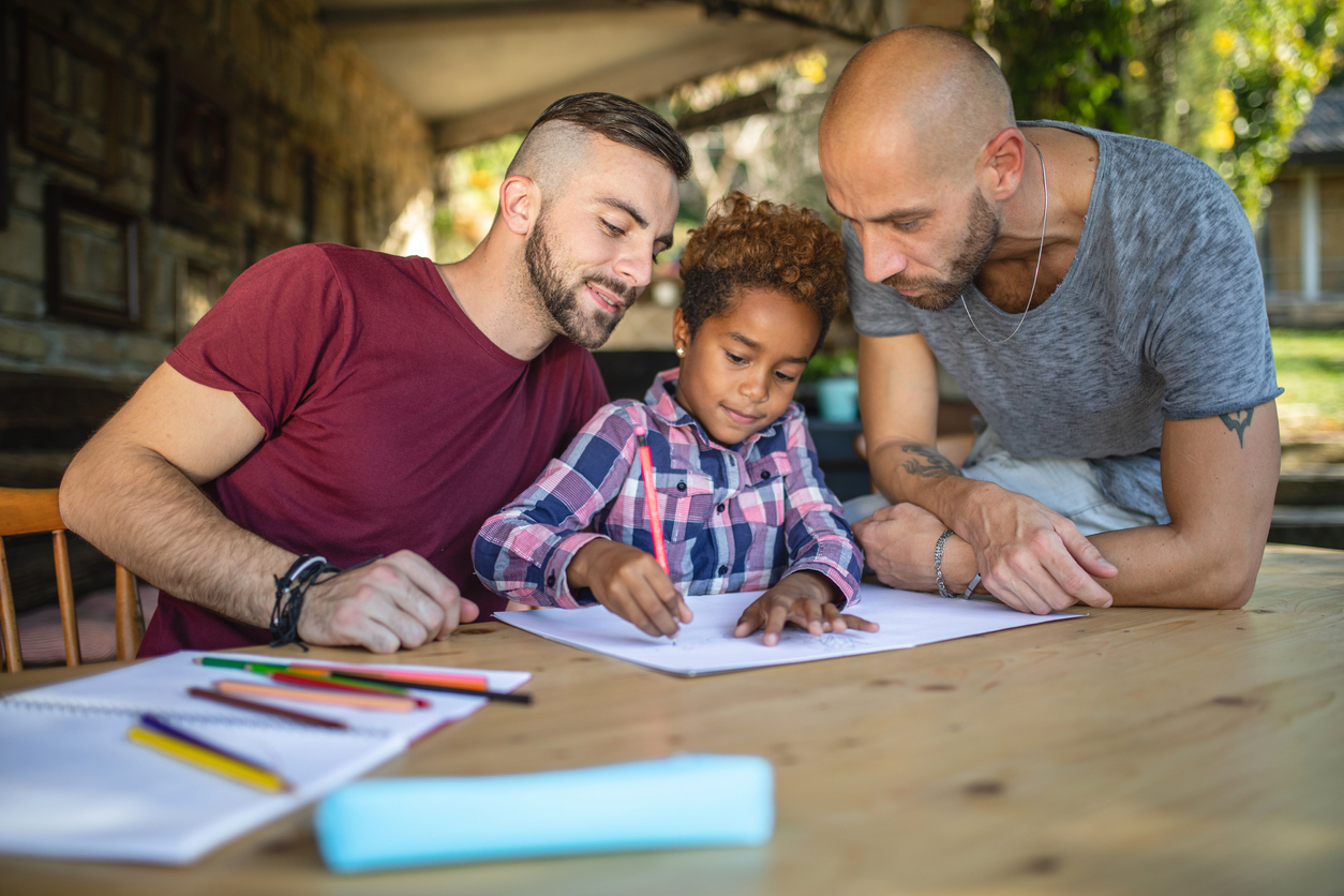 Couple doing homework with their child