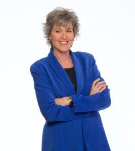 Portrait of Tara Brown in a Blue Blazer