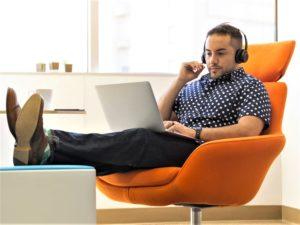 Man listening to music in an orange chair