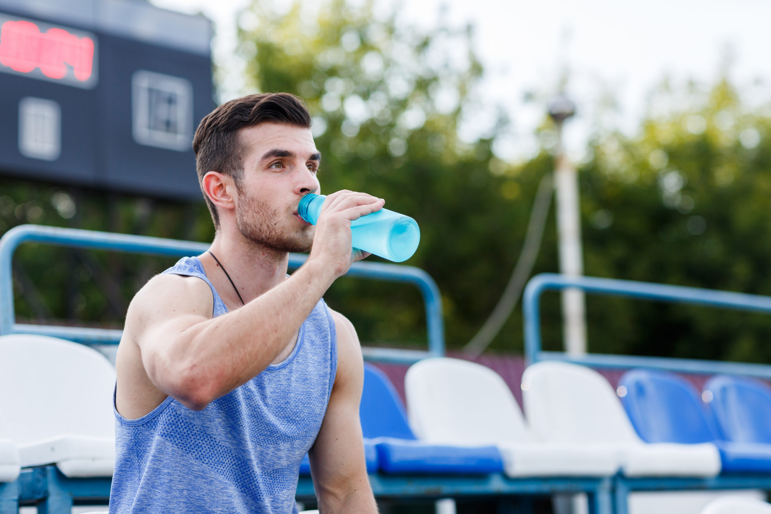 Man Hydrating Exercise Outdoors